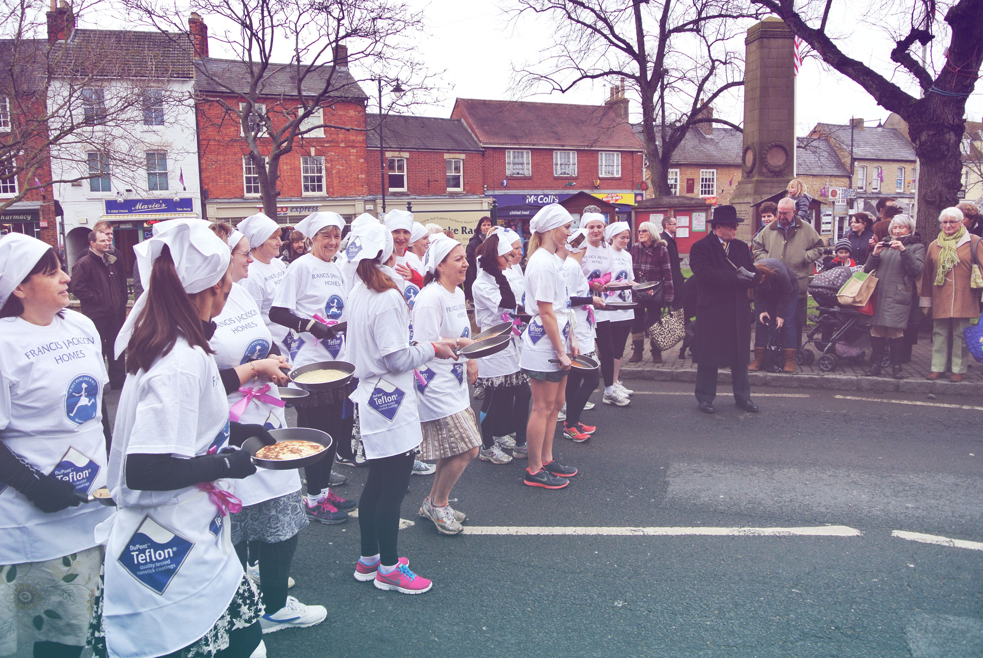 The girls line up at the start of the Olney Pancake Race